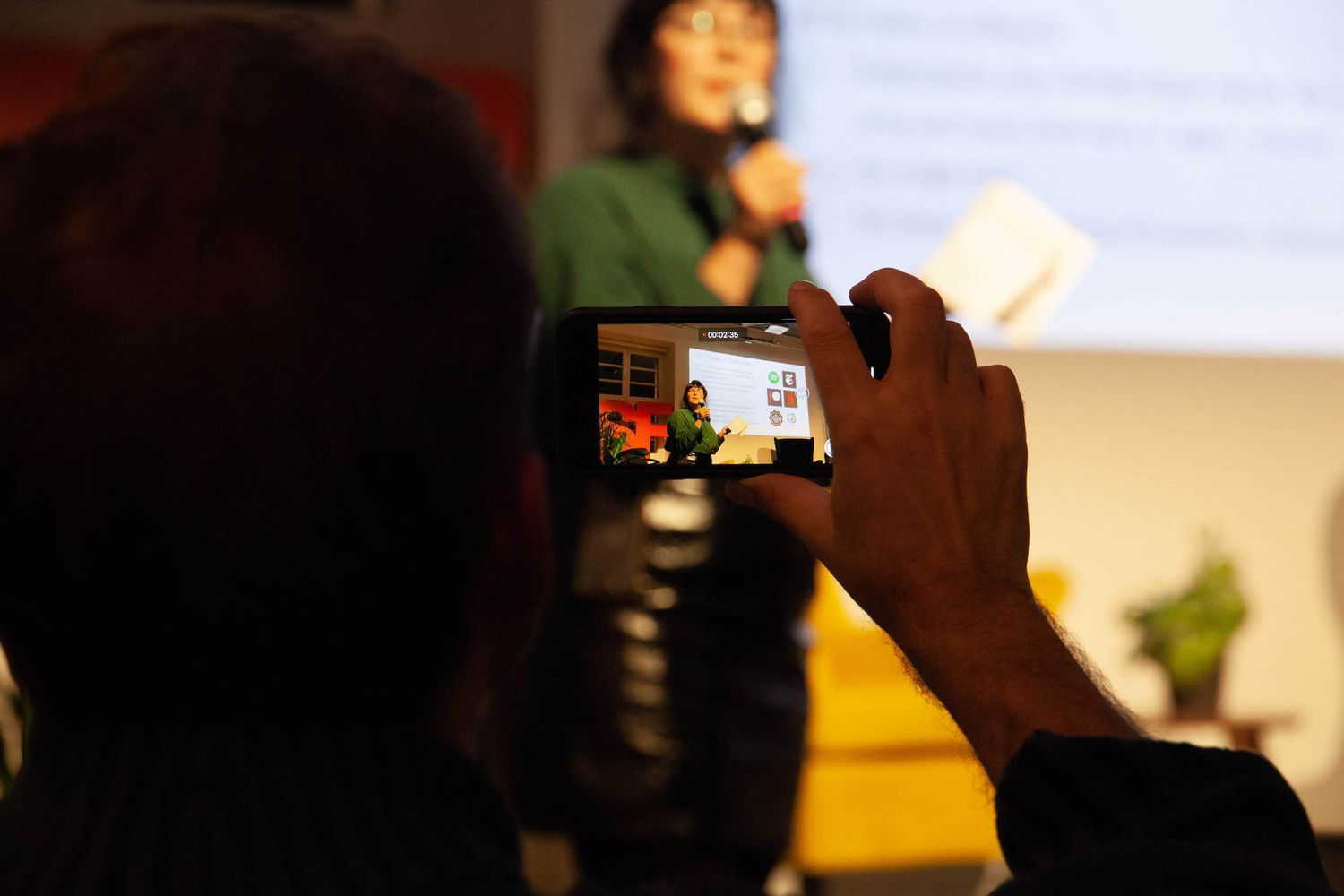 A person taking photos on the N3XTCODER meetup